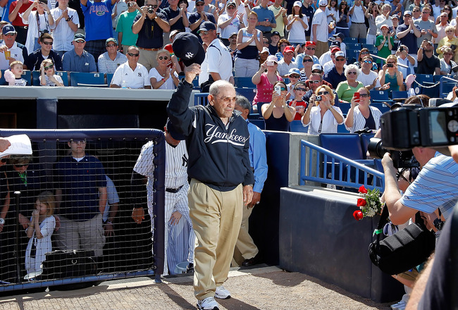 TAMPA, FL - FEBRUARY 26:  Hall of Famer Yogi Berra of the New York Yankees tips his hat to the crowd as he is announced just prior to the start of the Grapefruit League Spring Training Game against the Philadelphia Phillies at George M. Steinbrenner Field