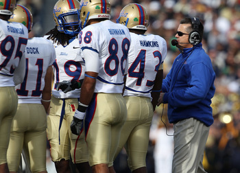 SOUTH BEND, IN - OCTOBER 30: Head coach Todd Graham of the Tulsa Golden Hurricane talks to his team including (L-R) Alan Dock #11, Milton Howell #19, Bryan Burnham #88 and Donnell Hawkins #43 during a game against the Notre Dame Fighting Irish at Notre Da