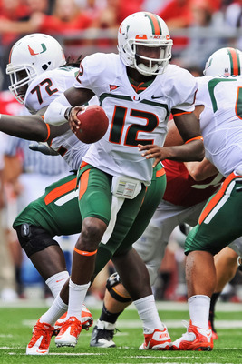 COLUMBUS, OH - SEPTEMBER 11:  Quarterback Jacory Harris #12 of the Miami Hurricanes runs with the ball against the Ohio State Buckeyes at Ohio Stadium on September 11, 2010 in Columbus, Ohio.  (Photo by Jamie Sabau/Getty Images)
