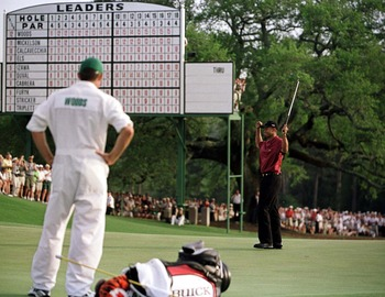 8 Apr 2001:  Tiger Woods of the USA celebrates with a birdie to win the Masters on the 18th green during the final day of the 2001 Masters at the Augusta National Golf Club, Augusta, GA, USA. Mandatory Credit: Stephen Munday/ALLSPORT
