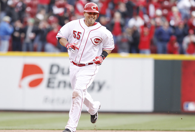 CINCINNATI, OH - MARCH 31: Ramon Hernandez #55 of the Cincinnati Reds rounds the bases after hitting the game-winning home run in the ninth inning against the Milwaukee Brewers in the opening day game at Great American Ballpark on March 31, 2011 in Cincin