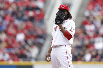 CINCINNATI, OH - MARCH 31: Edinson Volquez #36 of the Cincinnati Reds covers his face with his glove in between pitches during the opening day game at Great American Ballpark on March 31, 2011 in Cincinnati, Ohio. (Photo by Joe Robbins/Getty Images)