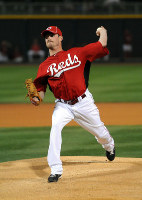 GOODYEAR, AZ - MARCH 03:  Travis Wood #30 of the Cincinnati Reds delivers a pitch against the Los Angeles Dodgers at Goodyear Ballpark on March 3, 2011 in Goodyear, Arizona.  (Photo by Norm Hall/Getty Images)