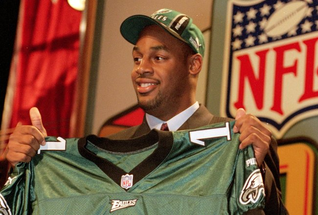 17 Apr 1999:  Donovan McNabb of the Philadelphia Eagles holds up his Eagles jersey during the NFL Draft at Madison Square Garden in New York, New York. Mandatory Credit: Ezra O. Shaw  /Allsport