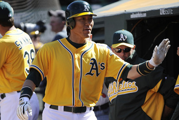 OAKLAND, CA - APRIL 3: Hideki Matsui #55 of the Oakland Athletics returns to the dougout after scoring a run in the seventh inning against the Seattle Mariners during a MLB baseball game at the Oakland-Alameda County Coliseum April 3, 2011 in Oakland, Cal