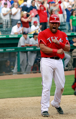 ARLINGTON, TX - APRIL 01:  Yorvit Torrealba #8 of the Texas Rangers reacts after scoring on a game winning RBI double hit by David Murphy #7 of the Texas Rangers in the bottom of the eighth inning against the Boston Red Sox on Opening Day at Rangers Ballp