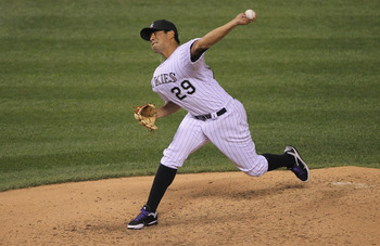 DENVER, CO - APRIL 02:  Starting pitcher Jorge De La Rosa #29 of the Colorado Rockies delivers against the Arizona Diamondbacks at Coors Field on April 2, 2011 in Denver, Colorado. De La Rosa earned the win as the Rockies defeated the Diamondbacks 3-1.  (