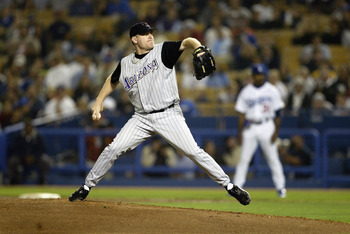 LOS ANGELES - SEPTEMBER 16:  Curt Schilling #38 of the Arizona Diamondbacks throws against the Los Angeles Dodgers during the game on September 16, 2003 at Dodger Stadium in Los Angeles, California.  The Diamondbacks defeated the Dodgers 3-2.  (Photo by J