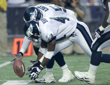9 SEP 01: William Hampton # 41 and Quinton Caver # 55 of the Philadelphia Eagles try to recover a fumble near the goal line at the end of the fourth quarter during the game against the St. Louis Rams at Veterans Stadium in Philadelphia, Pennsylvania. DIGI