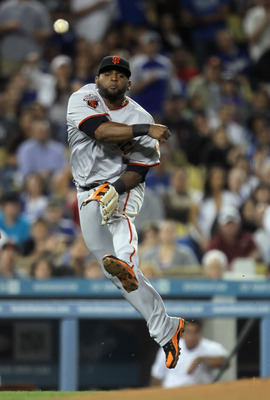 LOS ANGELES, CA - APRIL 01:  Third baseman Pablo Sandoval #48 of the San Francisco Giants throws to first resulting in an error in the sixth inning against the Los Angeles Dodgers at Dodger Stadium on April 1, 2011 in Los Angeles, California. The Dodgers