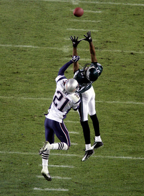 JACKSONVILLE, FL - FEBRUARY 6:  Wide receiver Todd Pinkston #87 of the Philadelphia Eagles goes up for a catch in front of Randall Gay #21 of the New England Patriots during Super Bowl XXXIX at Alltel Stadium on February 6, 2005 in Jacksonville, Florida.