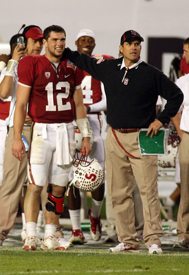 MIAMI, FL - JANUARY 03:  (L-R) Quarterback Andrew Luck #12 and head coach Jim Harbaugh of the Stanford Cardinal look on from the sideline late in the fourth quarter against the Virginia Tech Hokies during the 2011 Discover Orange Bowl at Sun Life Stadium