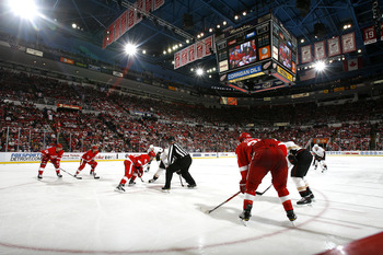 DETROIT - OCTOBER 08:  Members of the Anaheim Ducks line up for a face-off against members of the Detroit Red Wings during their NHL game at Joe Louis Arena on October 8, 2010 in Detroit, Michigan.(Photo by Dave Sandford/Getty Images)