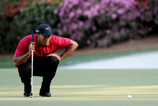 AUGUSTA, GA - APRIL 11:  Tiger Woods lines up a putt on the 13th green during the final round of the 2010 Masters Tournament at Augusta National Golf Club on April 11, 2010 in Augusta, Georgia.  (Photo by Harry How/Getty Images)