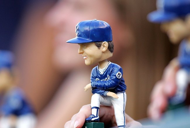 KANSAS CITY, MO - JULY 22:  A fan displays a bobblehead of former manager Dick Howser of the Kansas City Royals during the game between the Royals and the Los Angeles Angels of Anaheim on Dick Howser bobblehead giveaway night on July 22, 2006 at Kauffman