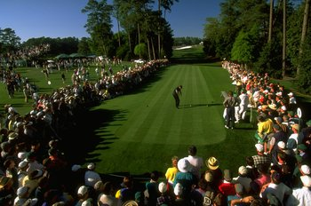 10 Apr 1997: Tiger Woods of the USA tees off at the 18th during the first day of the US Masters at Augusta, Georgia. Woods went on to win the tournament with a record low score of 270, eighteen under par. \ Mandatory Credit: Stephen Munday /Allsport
