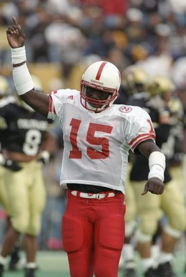 28 Oct 1995: Quarterback Tommie Frazier of the Nebraska Cornhuskers celebrates during a game against the Colorado Buffaloes at Folsom Field in Boulder, Colorado. Nebraska won the game 42-10.