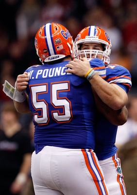 NEW ORLEANS - JANUARY 01:  Tim Tebow #15 of the Florida Gators hugs teammate Mike Pouncey #55 after scoring a touchdown against the Cincinnati Bearcats during the Allstate Sugar Bowl at the Louisana Superdome on January 1, 2010 in New Orleans, Louisiana.