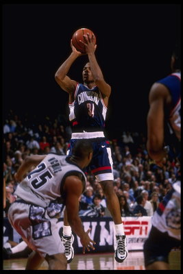 19 Feb 1996: Guard Ray Allen of the Connecticut Huskies takes a jump shot in front of the defense of the Georgetown Hoyas in this Big East match-up at the USAir Arena in Washington, D.C. Georgetown defeated UConn 77-65.