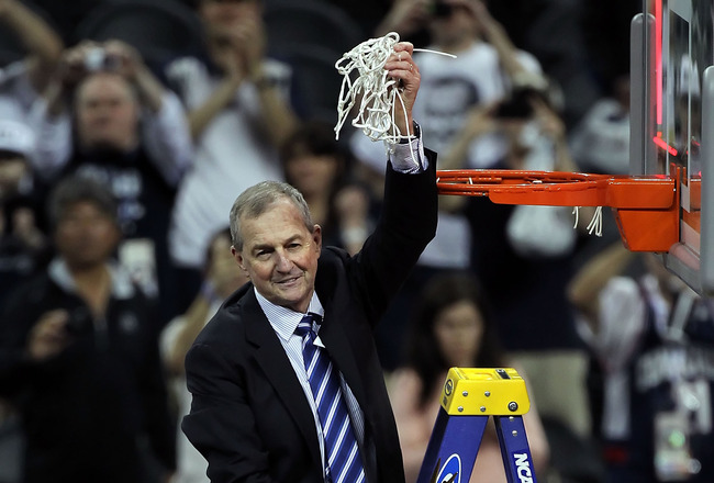 HOUSTON, TX - APRIL 04:  Head coach Jim Calhoun of the Connecticut Huskies cuts down the net after defeating the Butler Bulldogs to win the National Championship Game of the 2011 NCAA Division I Men's Basketball Tournament by a score of 53-41 at Reliant S