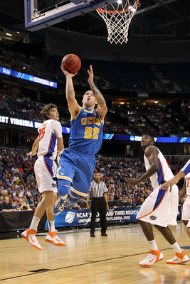 TAMPA, FL - MARCH 19:  Reeves Nelson #22 of the UCLA Bruins drives for a shot attempt against Chandler Parsons #25 and Patric Young #4 of the Florida Gators during the third round of the 2011 NCAA men's basketball tournament at St. Pete Times Forum on Mar