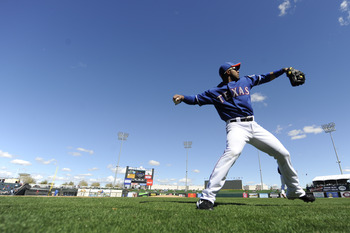 SURPISE, AZ - FEBRUARY 27: Elvis Andrus #1 of the Texas Rangers warms up before a spring training game against the Kansas City Royals at Surprise Stadium on February 27, 2011 in Surprise, Arizona. (Photo by Rob Tringali/Getty Images)
