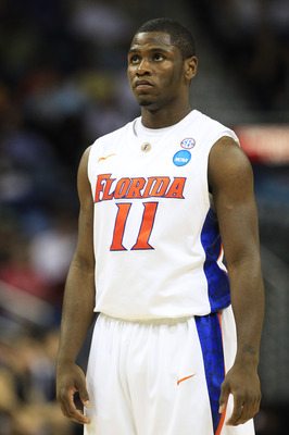 NEW ORLEANS, LA - MARCH 26:  Erving Walker #11 of the Florida Gators reacts during their game against the Butler Bulldogs in the Southeast regional final of the 2011 NCAA men's basketball tournament at New Orleans Arena on March 26, 2011 in New Orleans, L
