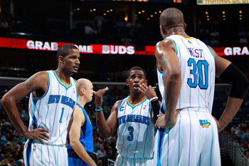 NEW ORLEANS - NOVEMBER 17:  Chris Paul #3 talks with Trevor Ariza #1 and David West #30 of the New Orleans Hornets during a timeout against the Dallas Mavericks at the New Orleans Arena on November 17, 2010 in New Orleans, Louisiana.  The Hornets defeated