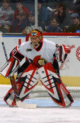 ATLANTA - NOVEMBER 25:  Patrick Lalime #40 of the Ottawa Senators eyes the play from the top of the crease against the Atlanta Thrashers at Philips Arena on November 25, 2003 in Atlanta, Georgia.  The Senators defeated the Thrashers 6-3.  (Photo by Scott