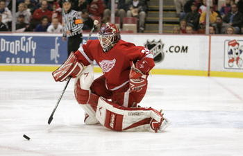 DETROIT - NOVEMBER 11:  Goaltender Manny Legace #34 of the Detroit Red Wings goes down to make a save on the Minnesota Wild during the NHL game on November 11, 2005 at Joe Louis Arena in Detroit, Michigan.  The Red Wings defeated the Wild 3-1.  (Photo By