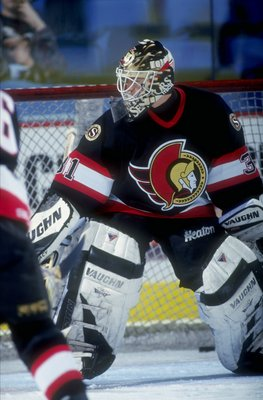 19 Apr 1998:  Goaltender Ron Tugnut of the Ottawa Senators in action during a game against the Buffalo Sabres at the Marine Midland Arena in Buffalo, New York. The Senators defeated the Sabres 2-1. Mandatory Credit: Craig Melvin  /Allsport