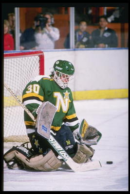 1991:  Goaltender Jon Casey of the Minnesota North Stars makes a save during a game. Mandatory Credit: Tim DeFrisco  /Allsport