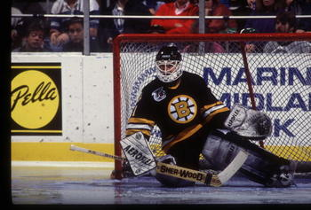 REGGIE LEMELIN OF THE BOSTON BRUINS SLIDES HIS BODY TO BLOCK HIS GOAL IN A GAME AGAINST THE BUFFALO SABRES