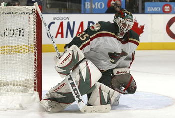 TORONTO - DECEMBER 26:  Manny Fernandez #35 of the Minnesota Wild makes a save on a shot from the Toronto Maple Leafs during their NHL game at the Air Canada Centre December 26, 2006 in Toronto, Ontario.  (Photo by Dave Sandford/Getty Images)