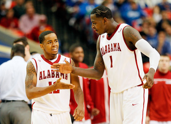ATLANTA, GA - MARCH 11:  JaMychal Green #1 and Trevor Releford #12 of the Alabama Crimson Tide celebrate after drawing a foul during the quarterfinals of the SEC Men's Basketball Tournament at Georgia Dome on March 11, 2011 in Atlanta, Georgia.  (Photo by