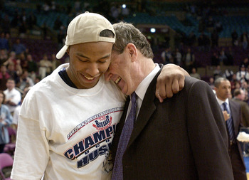 9 Mar 2002:  Caron Butler #3 of Connecticut, who was the tournament MVP, hugs head coach Jim Calhoun before he received his MVP award after the finals of the Big East Touranment at Madison Square Garden in New York City. UConn beat Pittsburgh 74-65. DIGIT