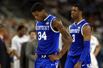 HOUSTON, TX - APRIL 02:  DeAndre Liggins #34 of the Kentucky Wildcats looks on Connecticut Huskies during the National Semifinal game of the 2011 NCAA Division I Men's Basketball Championship at Reliant Stadium on April 2, 2011 in Houston, Texas.  (Photo