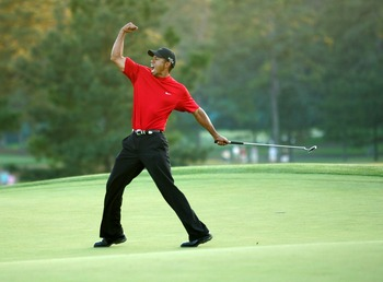 AUGUSTA, GA - APRIL 10:  Tiger Woods celebrates after sinking a putt on the first playoff hole to win the 2005 Masters on April 10, 2005 at Augusta National Golf Course in Augusta, Georgia.  (Photo By Getty Images)