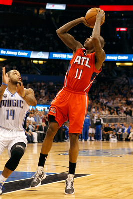 ORLANDO, FL - APRIL 19:  Jamal Crawford #11 of the Atlanta Hawks shoots against the Orlando Magic during Game Two of the Eastern Conference Quarterfinals of the 2011 NBA Playoffs on April 19, 2011 at the Amway Arena in Orlando, Florida.  NOTE TO USER: Use