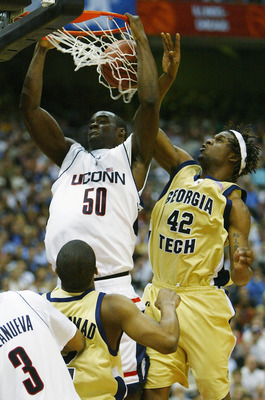 SAN ANTONIO - APRIL 5:  Emeka Okafor #50 of the UConn Huskies dunks the ball around the defense of Clarence Moore #42 of the Georgia Tech Yellow Jackets during the National Championship game of the NCAA Men's Final Four Tournament at the Alamodome on Apri