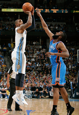 DENVER, CO - APRIL 23:  J.R. Smith #5 of the Denver Nuggets pulls up from three-point range against James Harden #13 of the Oklahoma City Thunder in Game Three of the Western Conference Quarterfinals in the 2011 NBA Playoffs at Pepsi Center on April 23, 2