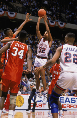 EAST RUTHERFORD, NJ - MARCH 22:  Tate George #32 of the UConn Huskies puts up a shot during the 1990 'sweet sixteen' NCAA Tournament basketball game against Clemson at the Meadowlands on March 22, 1990 in East Rutherford, New Jersey.  As time expires, Tat