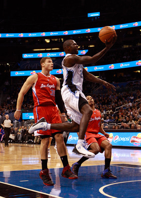 ORLANDO, FL - FEBRUARY 08:  Jason Richardson #23 of the Orlando Magic drives past Blake Griffin #32 of the Los Angeles Clippers during the game at Amway Arena on February 8, 2011 in Orlando, Florida.  NOTE TO USER: User expressly acknowledges and agrees t