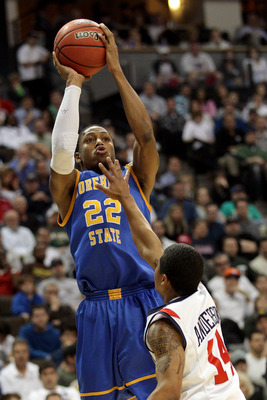 DENVER, CO - MARCH 19:  Demonte Harper #22 of the Morehead State Eagles shoot over Kevin Anderson #14 of the Richmond Spiders during the third round of the 2011 NCAA men's basketball tournament at Pepsi Center on March 19, 2011 in Denver, Colorado.  (Phot