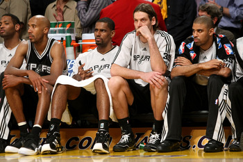 LOS ANGELES, CA - MAY 29:  (L-R) Robert Horry #25, Bruce Bowen #12, Kurt Thomas #40, Fabricio Oberto #7 and Ime Udoka #5 of the San Antonio Spurs sit on the bench in the final moments of the Spurs loss to the Los Angeles Lakers in Game Five of the Western