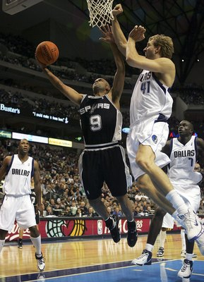 DALLAS - NOVEMBER 02: Guard Tony Parker #9 of the San Antonio Spurs takes a shot against Dirk Nowitzki #41 of the Dallas Mavericks at the American Airlines Center on November 2, 2006 in Dallas, Texas. NOTE TO USER: User expressly acknowledges and agrees t