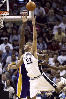 SAN ANTONIO - MAY 2:  Tim Duncan #21 of the San Antonio Spurs shoots over Shaquille O'Neal #34 of the Los Angeles Lakers during game one of the Western Conference Semifinals during the 2004 NBA Playoffs on May 2, 2004 at the SBC Center in San Antonio, Tex