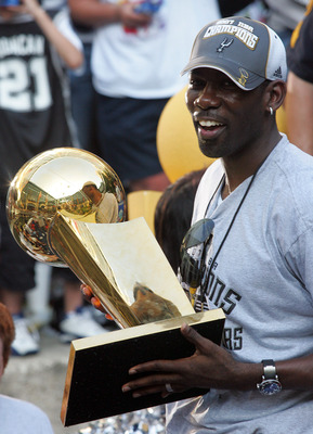 SAN ANTONIO - JUNE 17:  Michael Finley of the San Antonio Spurs holds the Larry O'Brien Championship trophy during the NBA championship parade down the San Antonio River walk June 17, 2007 in San Antonio, Texas. NOTE TO USER: User expressly acknowledges a