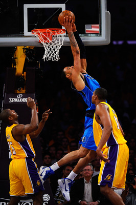 LOS ANGELES, CA - MAY 02:  Tyson Chandler #6 of the Dallas Mavericks dunks the ball over his head as Andrew Bynum #17 of the Los Angeles Lakers looks on in the first quarter of Game One of the Western Conference Semifinals in the 2011 NBA Playoffs at Stap