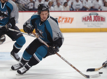 22 Apr 2002: Gary Suter #20 of the San Jose Sharks controls the puck against the Phoenix Coyotes during the game four of the Stanley Cup playoffs at America West Arena in Phoenix, Arizona. The Sharks won 4-1. DIGITAL IMAGE. Mandatory Credit: Harry How/Get